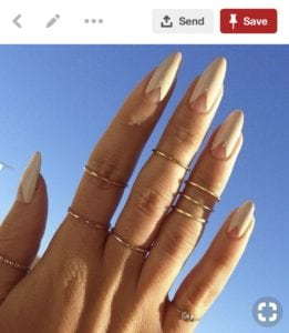 Pinterest image of white almond shaped nails with negative space triangles