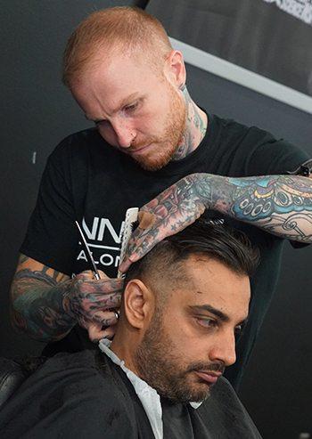 Student barber giving an undercut